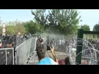 The moment police on the Hungary-Serbia border started using tear gas and water cannon on migrants